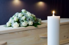 candle and wooden coffin