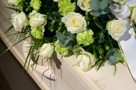 White flowers on coffin