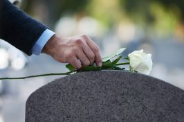 placing of flower on gravestone