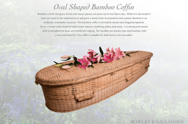 oval bamboo coffin with flowers