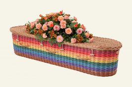 rainbow wicker coffin with funeral flowers